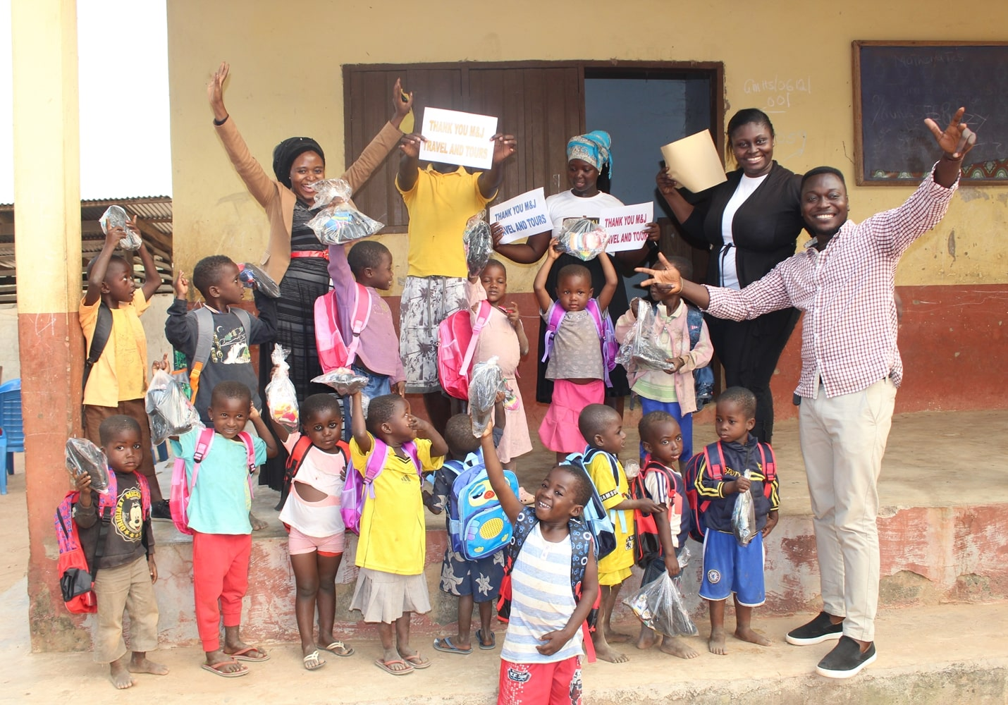 M&J making a donation at Mognori, Ghana